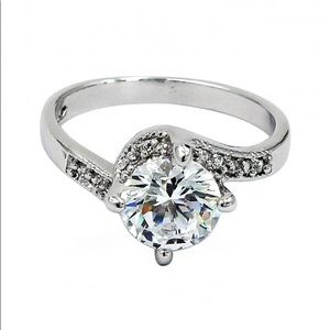 Four grabbed twisted arm crystal ring